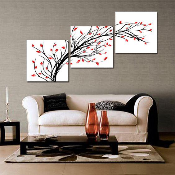 Белая модульная картина над диваном с простым рисунком